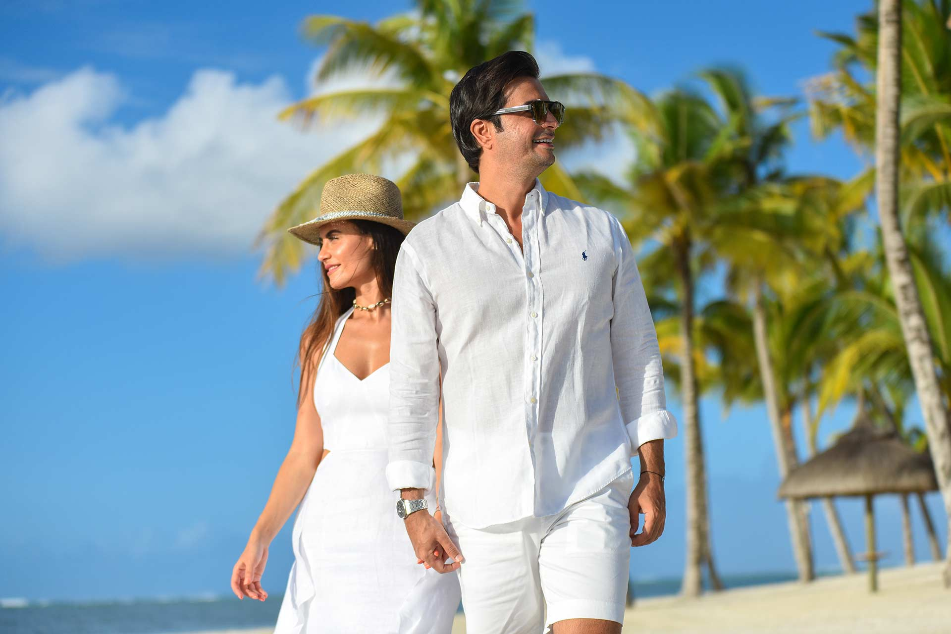 Classy Couple with white clothing on Tropical Beach